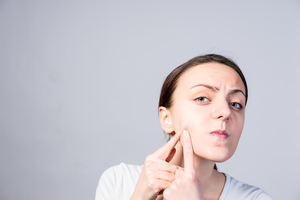 Avoid squeezing or popping up the pimples